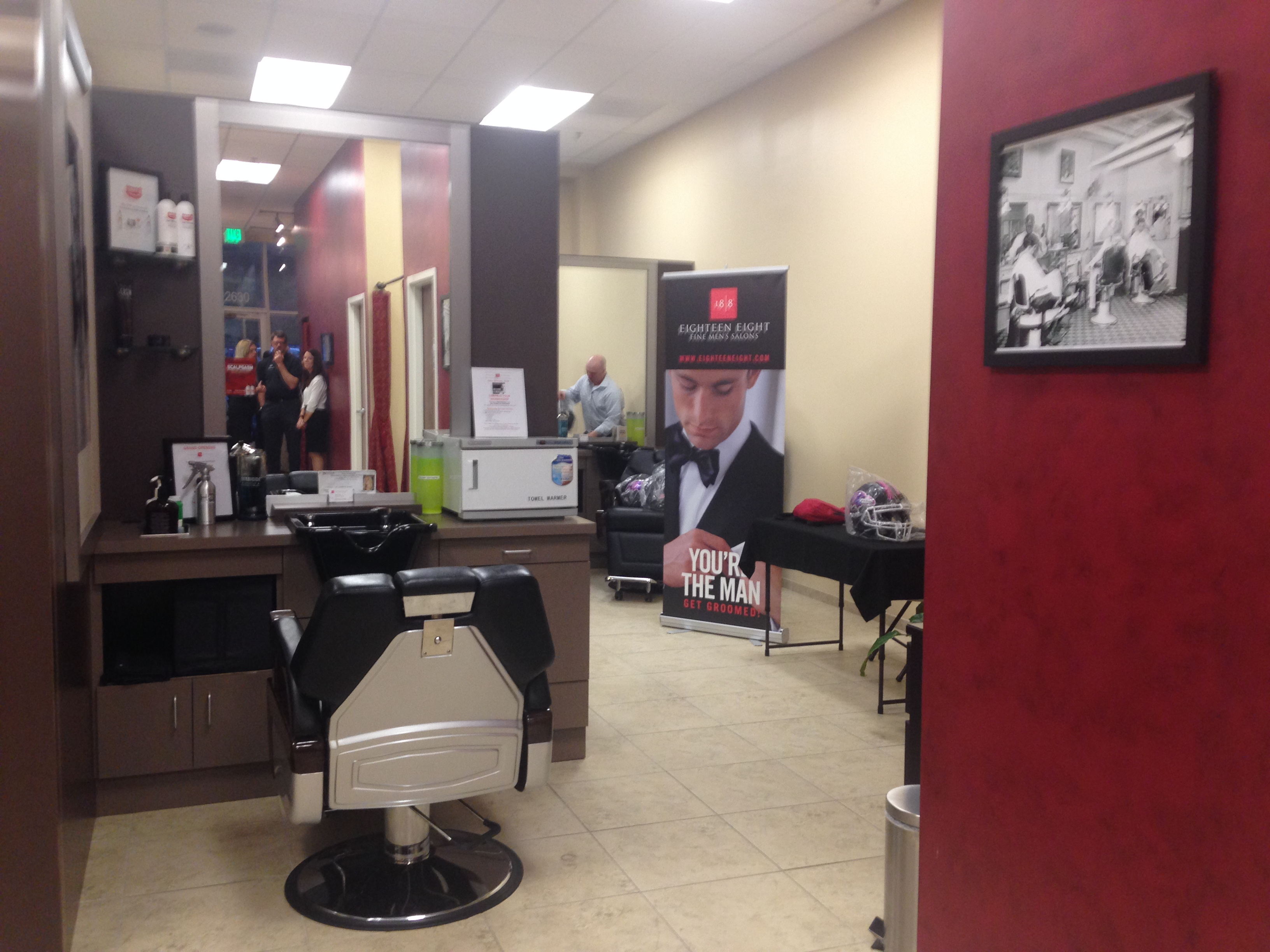 Pikesville men s salon celebrates debut with justin tucker for 2 the nines salon