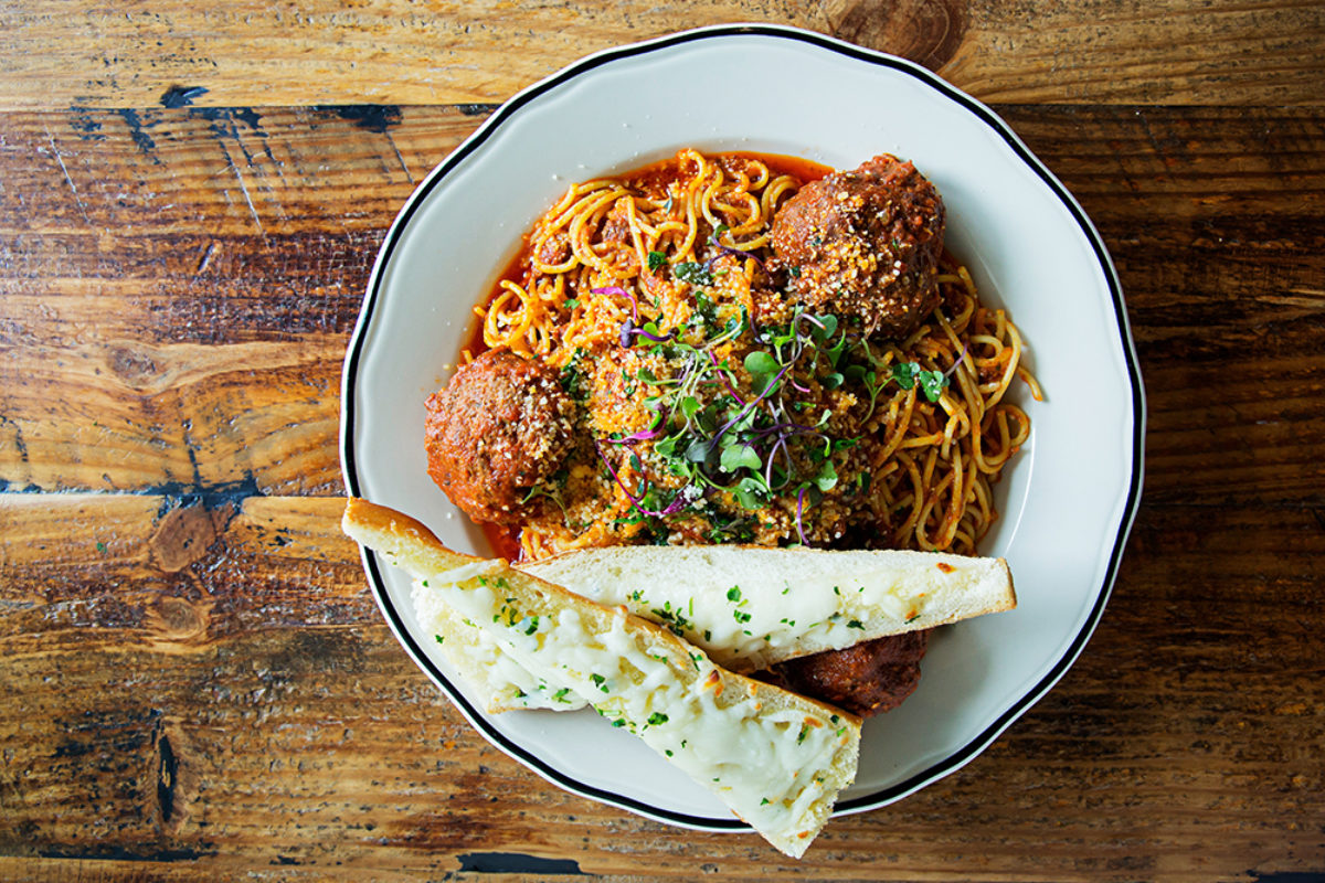 The spaghetti and meatballs in marinara with cheesy garlic bread.Photography by Scott Suchman