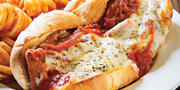 Chicken parmigiana sub and curly fries.Photography by Scott Suchman