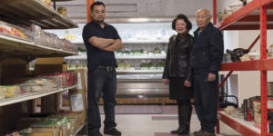 Chaw-Kim Toung, left, with his mother Mun-Ge Toung and father Henry Toung at their store Asia Food in Govans.Photography by David Colwell
