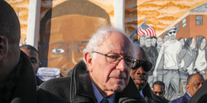 Presidential candidate Bernie Sanders stands in front of a mural paying tribute to Freddie Gray in Sandtown.Photography by Meredith Herzing