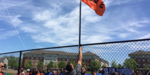 Raising the flag close to the spot where Frank Robinson's home run left Memorial Stadium.Photography by Ron Cassie