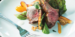Lamb chops with rutabaga and greens.Photography by Scott Suchman
