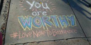 Chalking love letters on city sidewalks is one of the many acts of kindness Thread volunteers will perform on Giving Tuesday.Courtesy of Love Notes to Baltimore
