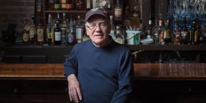 Kim Firestone sitting at the bar of his Frederick restaurant Firestone's Culinary Tavern.Photography by David Colwell