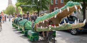 Tick Tock the Croc!, 2014 Grand Champion in the Baltimore Kinetic Sculpture Race, cruises through the Butchers' Hill neighborhood.Courtesy of AVAM