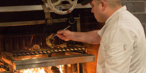 Chef Ben Lefenfeld grilling octopus.Photography by Janet Kahoe Photography
