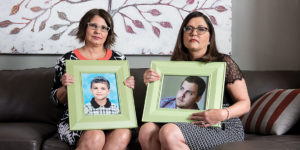 Angie, left, and Laura Pogliano, hold pictures of Laura's son, ZacPhotography by Mike Morgan