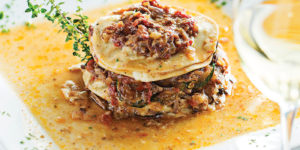 Lamb moussaka with tomatoes and eggplant.Photography by Scott Suchman