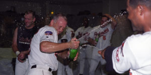 Left to right: Chris Hoiles, Cal Ripken Jr., Arthur Rhodes, and Aaron Ledesma celebrate in the clubhouse in 1997. Baltimore Orioles