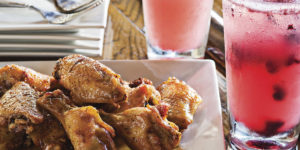 Refreshing blueberry margaritas and wings.Photography by Scott Suchman