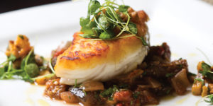 The pan-roasted halibut with eggplant caponataPhoto by Ryan Lavine