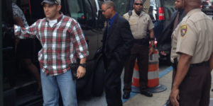 Caesar Goodson, center, stepping into a van ahead of William Porter following an early pre-trial motion hearing.Ron Cassie