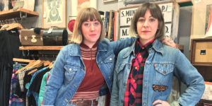 Kate Thomas, left, and Angie Gavin pose inside of their Hampden boutique, Milk and Ice Vintage.Photography by Sydney Adamson