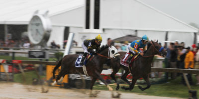 American Pharoah's muddy finish at the Preakness Stakes.Photography by Meredith Herzing