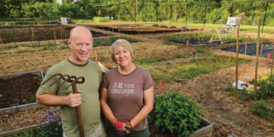 Master gardeners and Woodberry residents Dave and Linda Nelson tend to their plot at the bottom of TV Hill.Photography by Mitro Hood