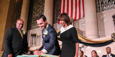 New 1st District City Councilman Zeke Cohen formally signing into office at the War Memorial building downtown Thursday.Photography by Meredith Herzing