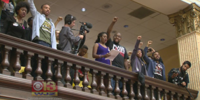 Activists at City Hall protesting City Council's approval of new police commissioner Kevin Davis.baltimore.cbslocal.com