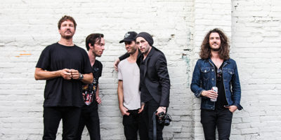 Third Eye Blind poses outside of The Sound GardenPhotography by Meredith Herzing