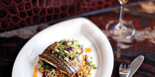 "B&O American Brasserie: ""rockfish could pass as red meat, dense with red-wine sauce and served with pumpkin-seed risotto and crispy broccoli raab.""Scott Suchman"