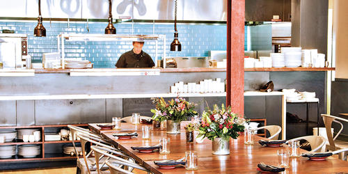 The Food Market's open  kitchen overlooks the sleek dining room. Photography by Scott Suchman