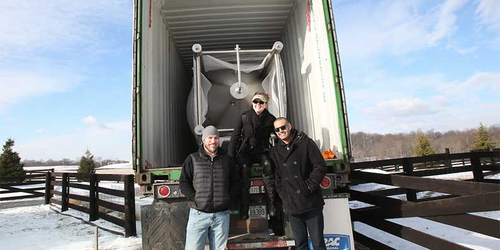 Tori Marriner, center, and head brewer Ben Little and Jason Gotcher pose with Manor Hill Brewing's first tank.Courtesy of Manor Hill Brewing