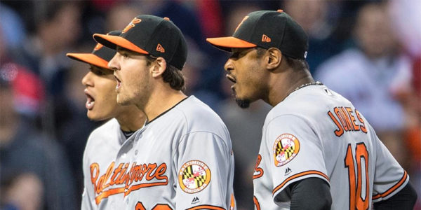 Manny Machado, Kevin Gausman, and Adam Jones react in Wednesday night's game.MASN