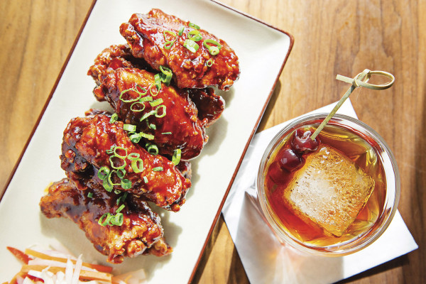 Korean chicken wings and a cocktail.Photography by Scott Suchman