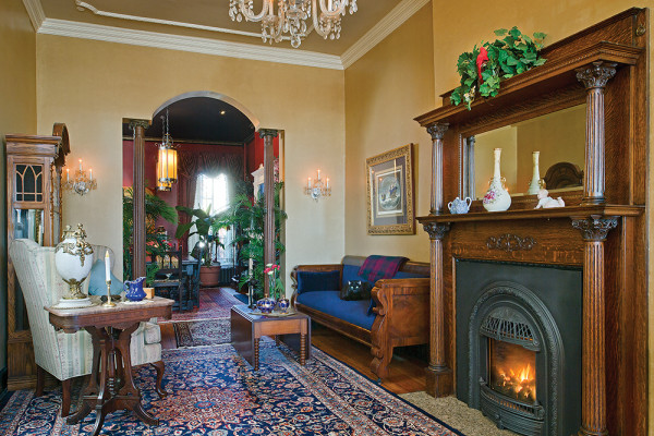 The home has two fireplaces true to the 1880s style, though one of the mantels is from an Eastern Avenue antique shop.Photography by Vince Lupo