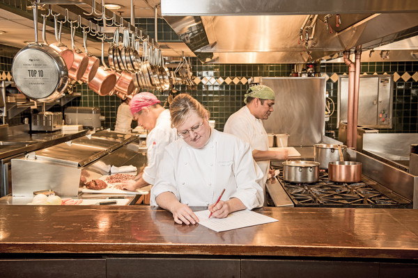 Chef Cindy Wolf in the kitchen at CharlestonPhotography by Mike Morgan