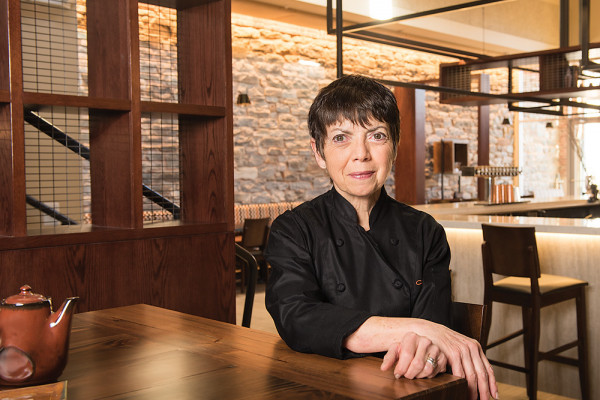 Donna Crivello sits inside her new space at Cosima in 