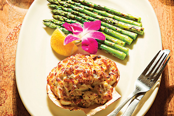 Crab imperial with asparagus and an orchid garnishPhoto by Scott Suchman