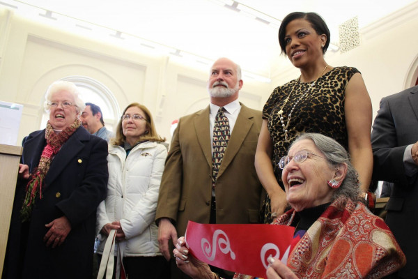 Mayor Stephanie Rawlings-Blake gave a piece of the ribbon to 95-year-old Mollie K. Witow, (bottom right) who often visited the Canton Branch as a child.Meredith Herzing