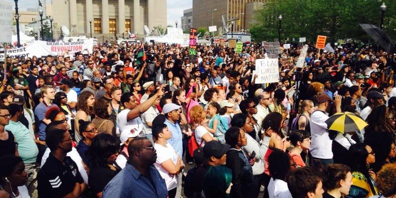 Demonstrators peacefully rallying at Baltimore's City Hall Saturday afternoon.Photograph by Ron Cassie